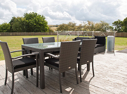 AB Sundecks Decking behind building with an array of chairs and tables