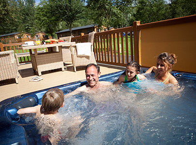 AB Sundecks Picket Panels, Picket Glass and Decking with a family in a hot tub